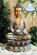 beleuchteter Buddhabrunnen mit drehender Kugel